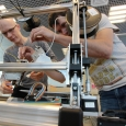 At the Skoltech composite lab, senior research scientist Fedor Antonov (right) and Mikhail Golubev, a design engineer, operate a 3D printer which produces a stiff and resilient composite material. The Moscow based team of researchers now aims to register